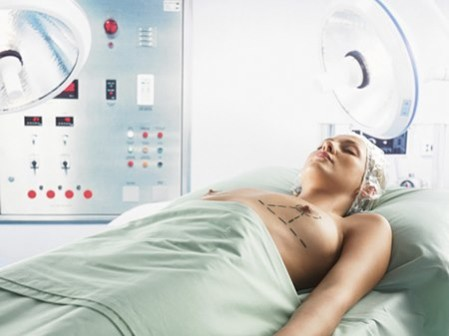 Woman Lying in an Operation Room With Dotted Lines Marked on Her Breasts