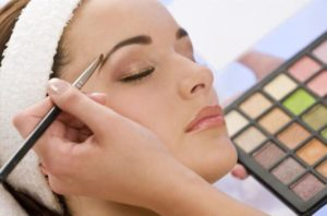 woman-having-make-up-applied